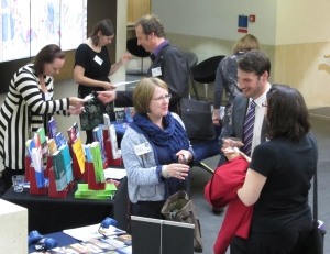 DREaM delegates chat beside the publishers' stands