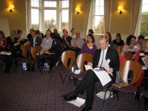 Dr Paul Lynch reviews his notes as the delegates eagerly await the first session of #lis_dream2